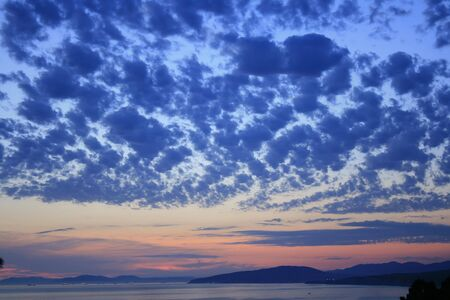 colorful sky scene at sunset above sea photo