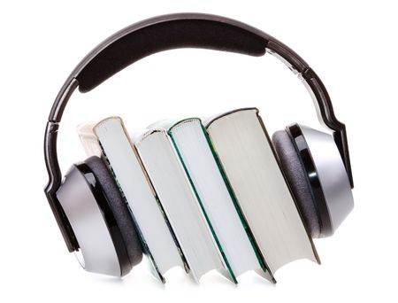 medium group of object: headphones and books (audio book concept)