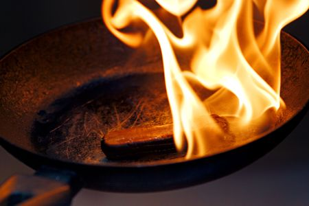 conflagration: sausage in the flame in frying pan