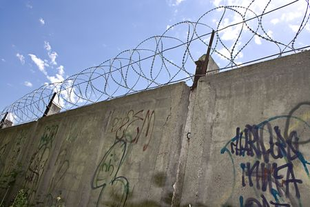 Barbed wire wall and blue sky Stock Photo - 5388830