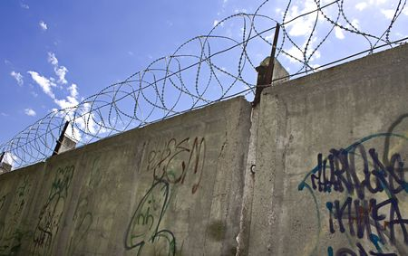 Barbed wire wall and blue sky Stock Photo - 5389107