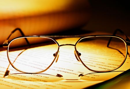 eyeglasses on the book close-up