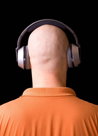 bald man listening to music photo