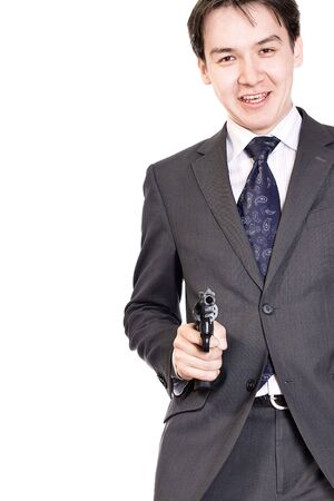 Portrait of a smiling young businessman with gun. photo