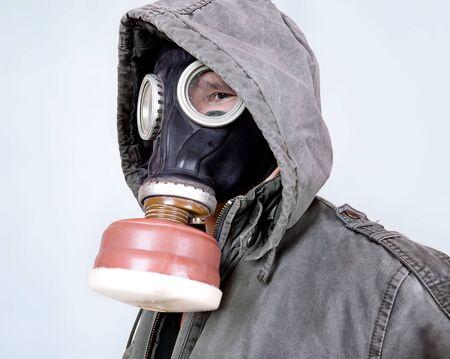 man wearing a gas mask photo