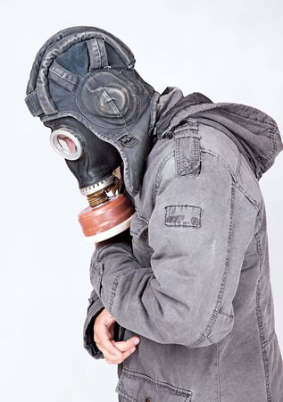 man wearing a gas mask photo