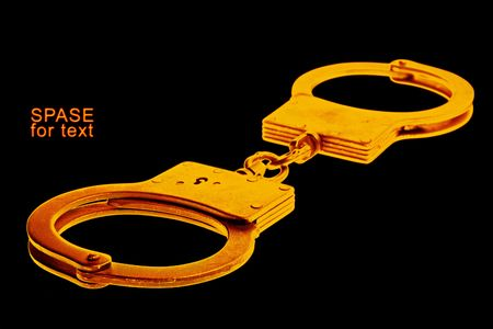 handcuffs isolated on black background Stock Photo - 5460899