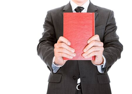 Businessman with book isolated on white background, space for head photo