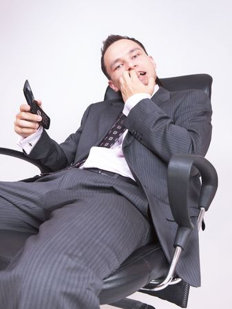 alarmed: alarmed businessman sitting on chair
