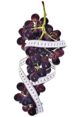 measuring tape around grapes photo
