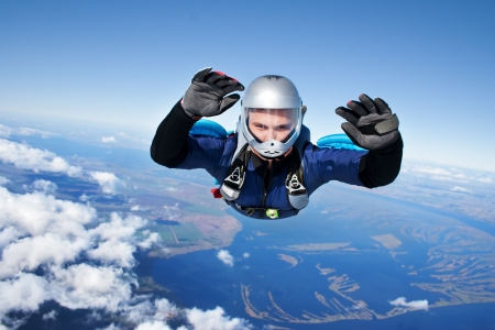 Skydiver falls through the air photo