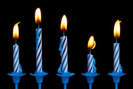 Birthday candles on a black background.