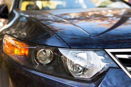 aggressive looking, car headlight closeup photo