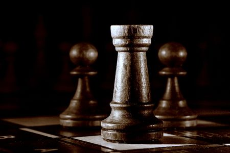 Chess on the dark background.
