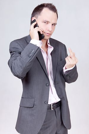 Portrait of business male model showing his love to you. photo