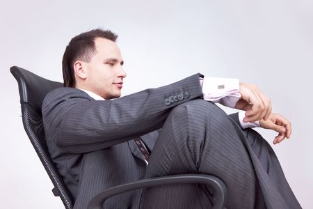 Portrait of business male model. Relaxing.