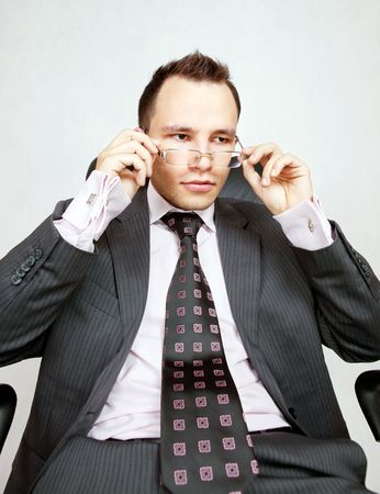 sceptical: Young businessman with a pair of modern glasses. Sceptical or interested. Stock Photo
