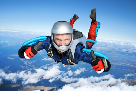 parachute jump: Skydiver falls through the air Stock Photo