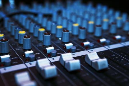 Music mixer desk in darkness. Stock Photo