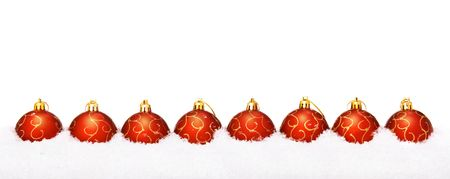 Background of perfect red christmas balls with snow, isolated on white. Stok Fotoğraf