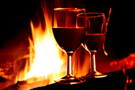 still life of wine: Vine against fire Stock Photo