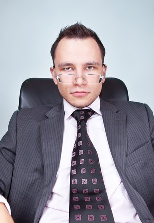 businessman sitting on chair look at you photo