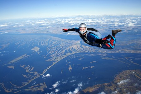 skydive: Skydiver falls through the air Stock Photo