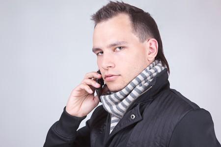 attractive young man talking on the phone portrait photo