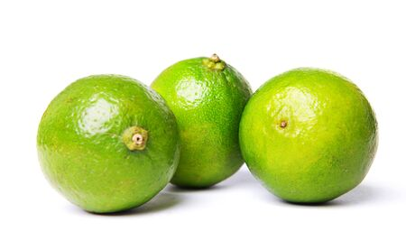 green limes isolated on white photo