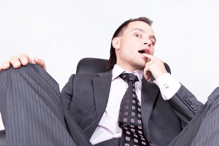 Young businessman sitting on chair photo