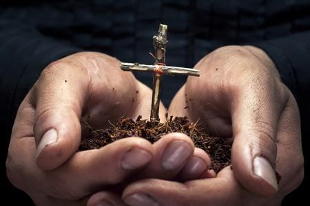 Cross in the hands Stock Photo