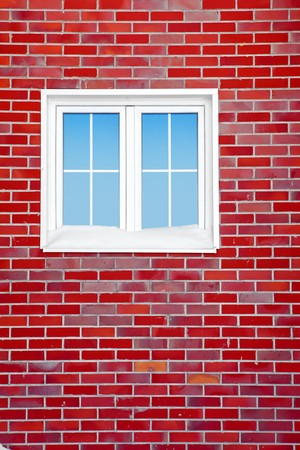 Brick wall with window. photo