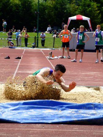 Young boy long jump