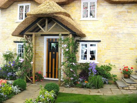house front: English home  with front door and garden Stock Photo