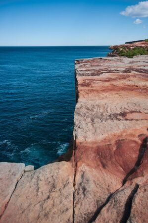 cliff face: red sandstone cliff face over pacific