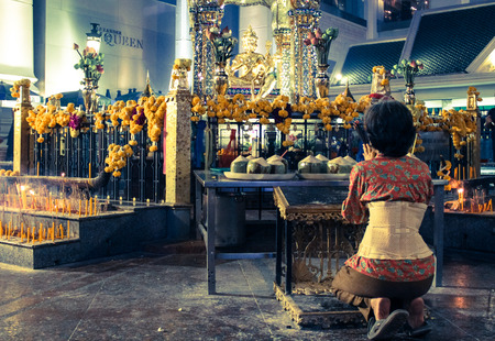 Thailand Woman Kneel In Front Four Face Buddha