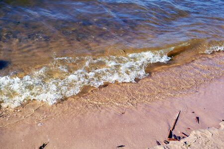 Hot summer on the Volga river. Cool water is refreshing. The rustle of the waves is soothing. Beauty. 스톡 콘텐츠