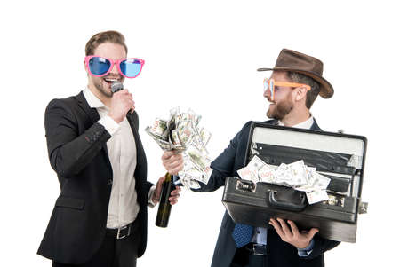 Showman announce happy jackpot winner holding money suitcase isolated on white, win Banque d'images