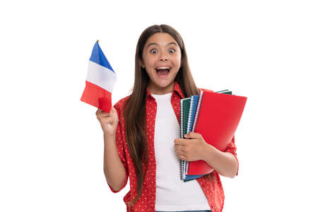 amazed kid hold french flag and school copybook for studying isolated on white, study abroad