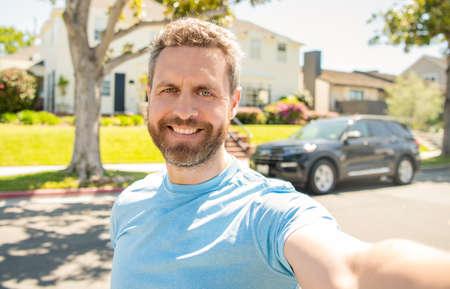 happy man making selfie face portrait outdoor, selfie