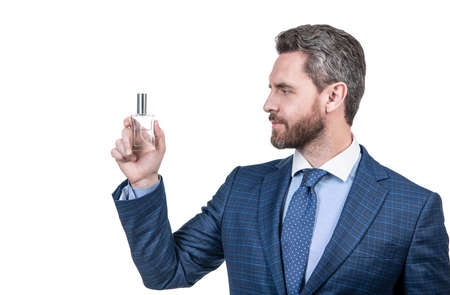 man in businesslike suit presenting product of mens perfume isolated on white, copy space, advert.