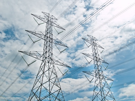 transmission line: electrical powerlines with blue sky and white clouds