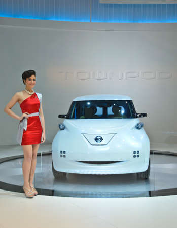 BANGKOK - MARCH 30: Nissan Zero emission car with unidentified model on display at The 33th Bangkok International Motor Show on March 30, 2012 in Bangkok, Thailand.