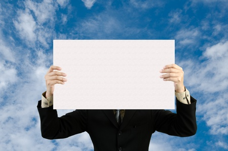 businessman holding blank sign  in sky photo