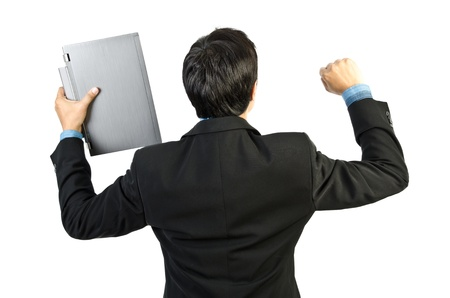 italian ethnicity: A happy excited businessman with holding a laptop and showing a fist of success, or victory. White background.