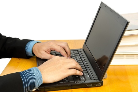 officetower: businessman hands on the laptop keyboard
