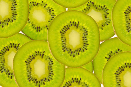 Closeup of Kiwi Fruit Slices as Background photo