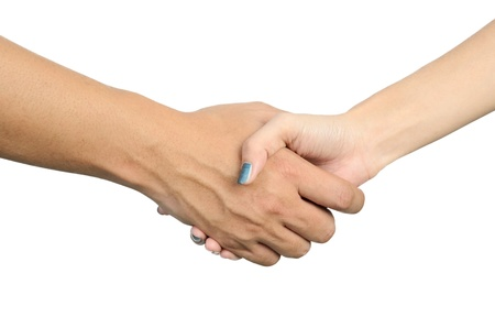 woman shaking hands with a man