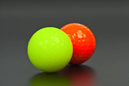 Green and orange golf ball