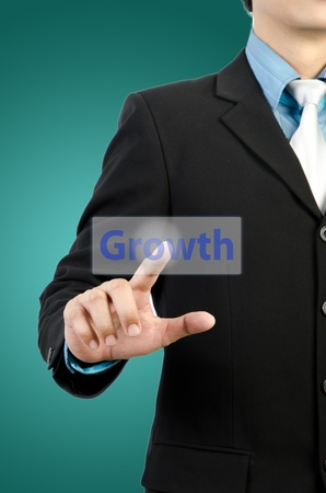 businessman hand touching growth button